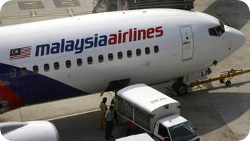 disappearance of malaysia plane: probe on into boarding of 4 persons with fake identities